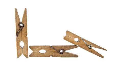wooden clothespin isolated on white background closeup Stock Photo