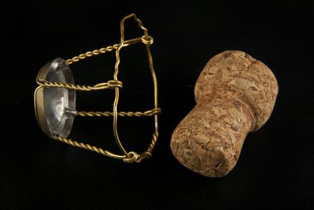 uncork: cork on black background closeup