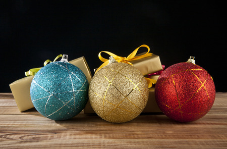 Christmas balls and gifts on a black background Stock Photo