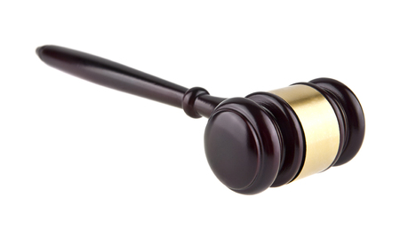 judicial proceeding: wooden gavel isolated on white background closeup