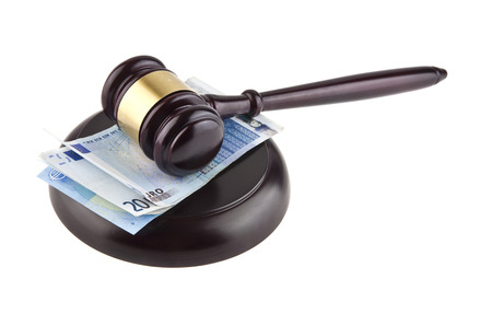 auction win: wooden gavel and European banknotes isolated on white background closeup