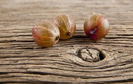 gooseberries on wooden background closeup