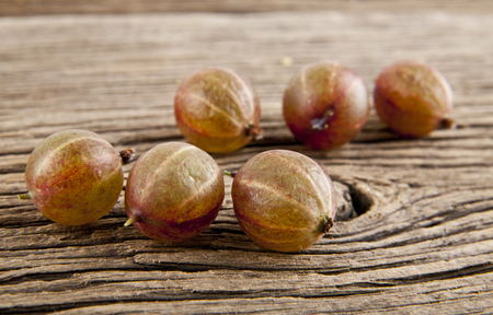 gooseberries on wooden background closeup