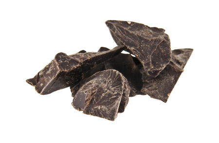 paleolithic: pieces of chocolate isolated on white background closeup Stock Photo