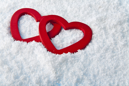 heart in to snow as a background