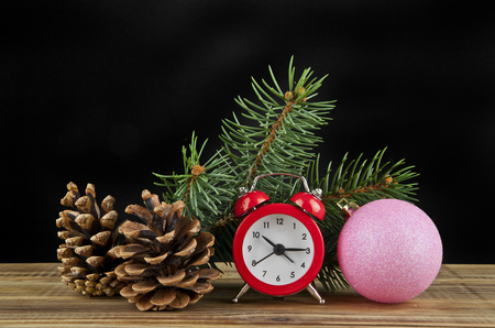 watch, Christmas balls and Christmas tree branch on black background