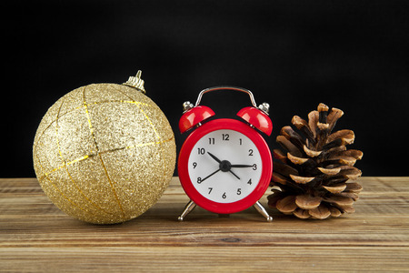 12 month old: Christmas balls, a clock and a bump on a black background