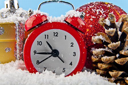 Christmas gifts watch and white snow on a blue background Stock Photo