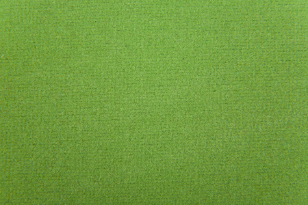 green fabric texture as background