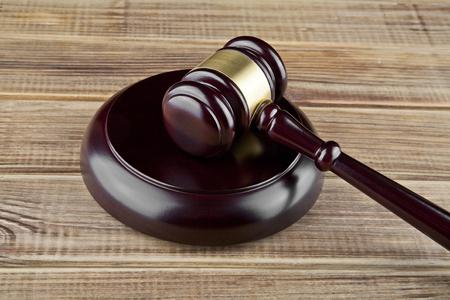 wooden gavel on wooden background