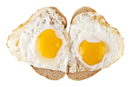 fried eggs on bread isolated on white background
