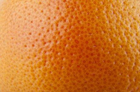 orange skin texture as background Фото со стока