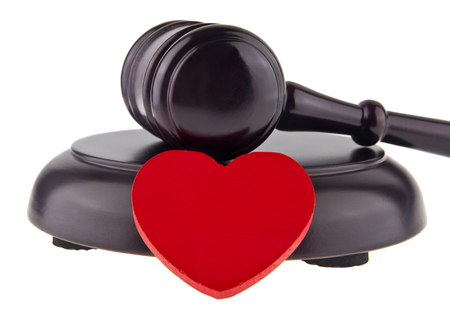 wooden hammer and red heart isolated on white background Stock Photo