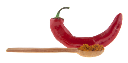 hot red pepper in a wooden spoon isolated on a white background Imagens