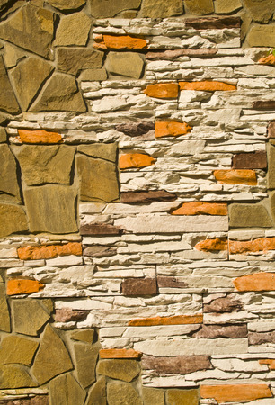 wall covered with various stones as a background Imagens