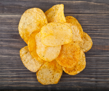 potato chips on a wooden background Stock Photo