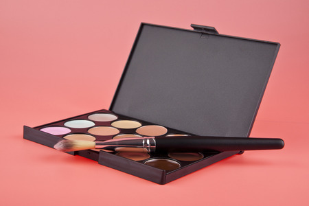 Cosmetic set on a pink background