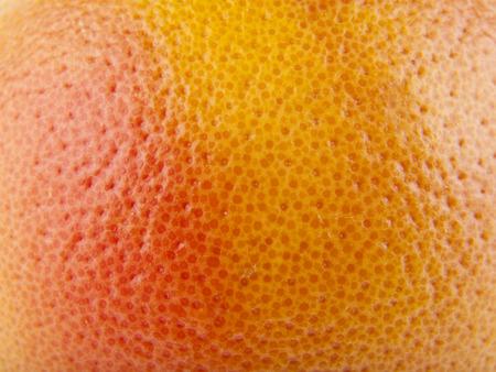 Orange skin as a background close-up