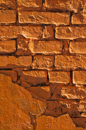 Old orange brick wall as a background close-up