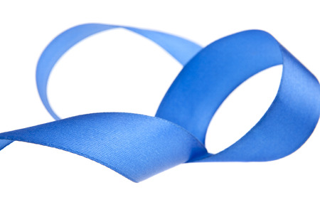 Blue ribbon isolated on white background close-up