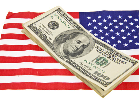 dollars on usa flag isolated on white background