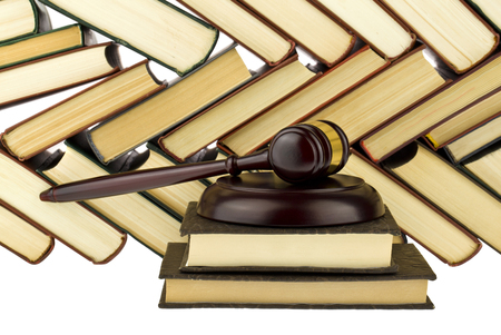 old hardcover books and wooden gavel isolated on white background