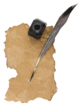 old paper, feather and inkwell isolated on white background. View from above