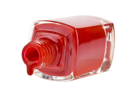 bottle with red nail polish isolated on white background close up