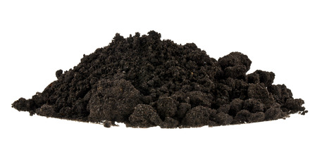 Pile of soil isolated on white background close up. Pieces of dirt, lumps.