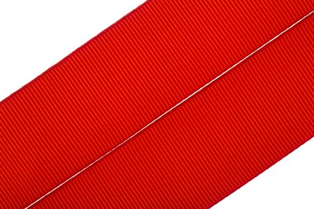 Red ribbon isolated on white background. Stock Photo