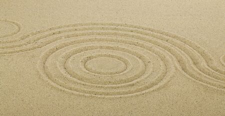 Zen drawing in the sand. The concept of harmony, balance and meditation, spa, relaxation. Abstract texture for background.