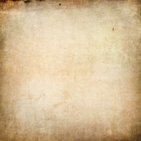 Texture of old faded vintage paper, beige retro background, grunge paper in spots and streaks with space for text