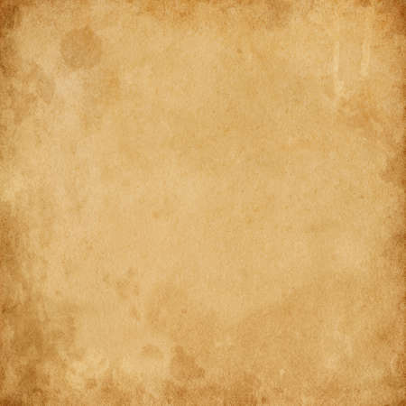 Old brown vintage paper with spots and streaks for design, empty space for text, texture of dirty rough paper Reklamní fotografie