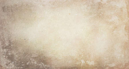 The texture of old faded vintage light beige paper in spots