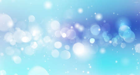 Festive blurred blue bokeh background with white circles for design with space for text