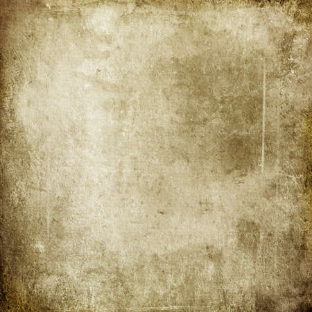Grunge background of old brown worn paper in spots and streaks for design and text Banque d'images