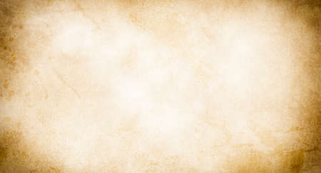 An old stained blank sheet of beige paper with a vignette