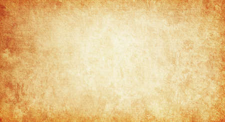 Grunge background of old brown paper with a light center for text