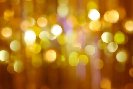 Abstract Christmas blurred background of golden Bokeh glitter