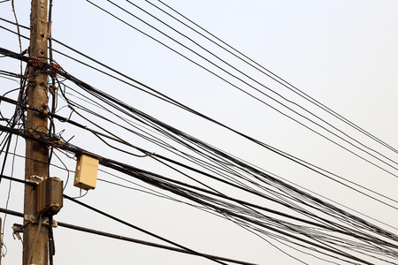 wire mess: electricity post Stock Photo