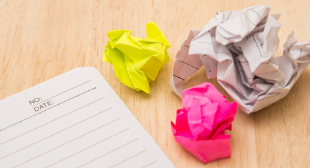 writer's block: Writers Block. Paper lump. on wooden background.