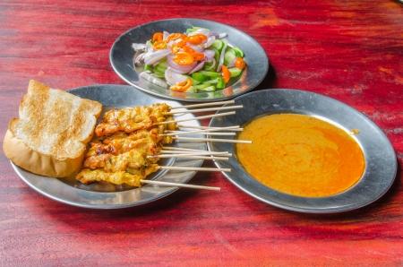 Pork satay with sauce , Thai style food  photo