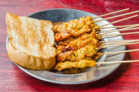 Pork satay with sauce , Thai style food. photo