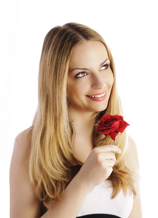 eyes hazel: Pretty young woman holding a rose