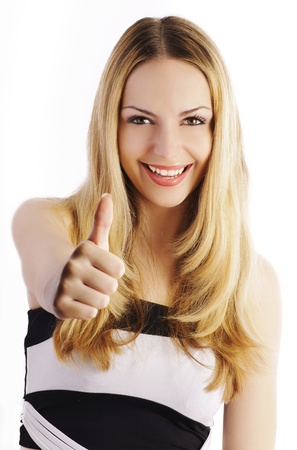 Beautiful girl smiling and showing thumbs up, isolated Stock Photo - 10883848