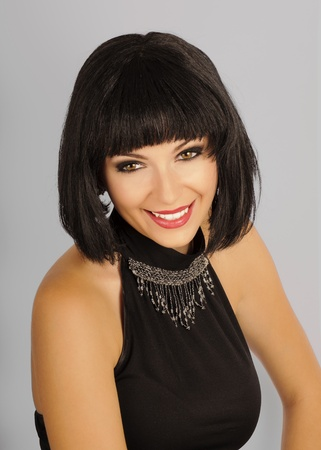 Cute girl with short black hair, smiling Stock Photo - 10883865