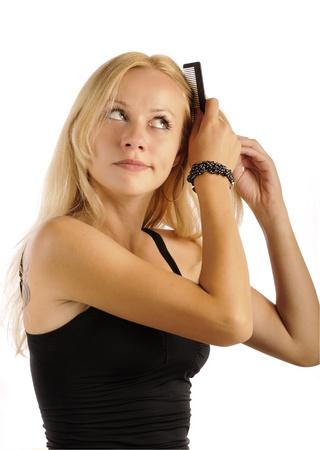 Beautiful girl combing her hair Stock Photo