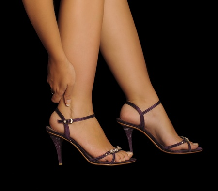 Pain from wearing high heels Stock Photo