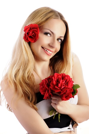 Beautiful blond girl with flower in her hair holding a bouquet of roses photo