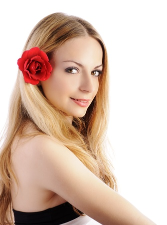 Pretty girl with flower in her hair photo